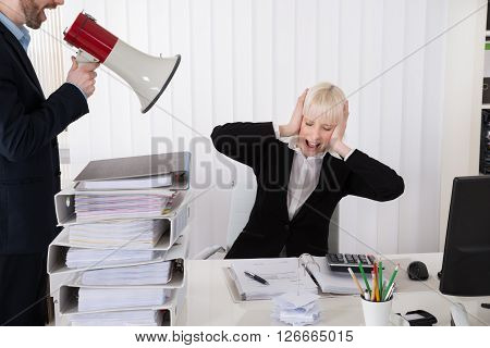 Boss Shouting At Businesswoman Through Loudspeaker
