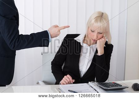 Man Bullying Woman In Office