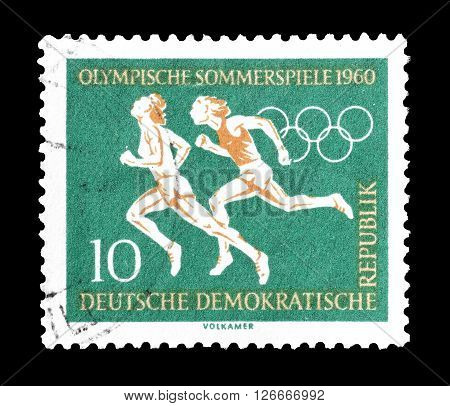 GERMAN DEMOCRATIC REPUBLIC - CIRCA 1960 : Cancelled postage stamp printed by German Democratic Republic, that shows Race.