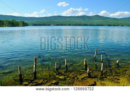 Summer water landscape - Turgoyak Lake in Southern Urals Russia. Turgoyak is a unique lake pure drinking water whose quality is similar to that of Baikal.