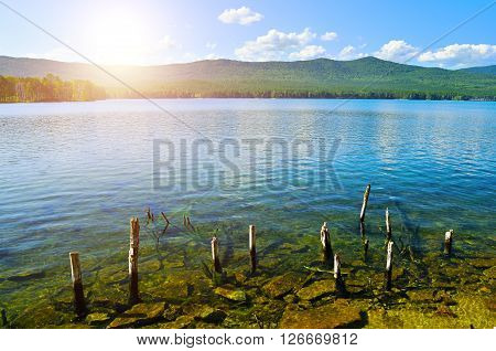 Colorful summer view of Turgoyak Lake in Southern Urals Russia. This deep lake is the most transparent in the Urals.