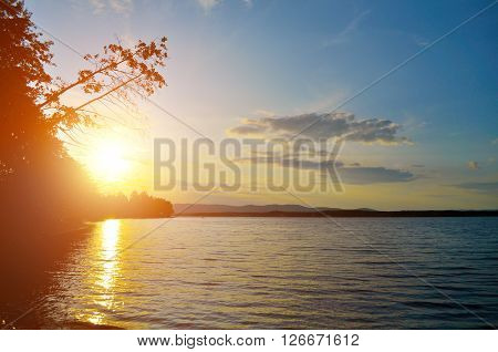 Summer landscape - sunset over the Irtyash lake in Southern Urals Russia