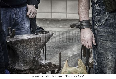 Old blacksmith anvil near in his forge.