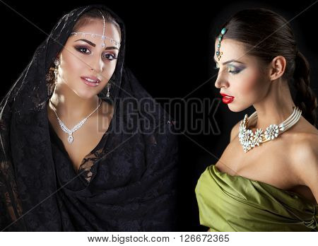 Collage two women in sari. Close up portrait of beautiful eastern models on a black background