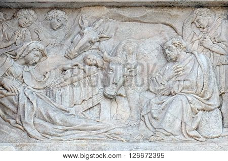 BOLOGNA, ITALY - JUNE 04: Nativity Scene, Adoration of the Shepherds, relief on portal of Saint Petronius Basilica in Bologna, Italy, on June 04, 2015