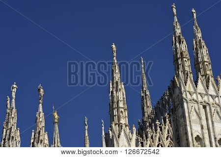 Details of the spires of Milan cathedral with clear sky