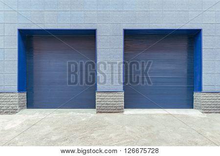 Metal blue gates of the shop storage.