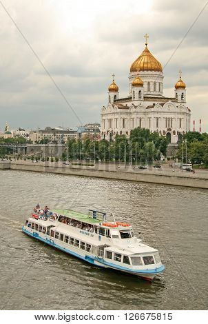Moscow, Russia - July 26, 2009: View On Moscow River With Pleasure Boat And Cathedral Of Christ The