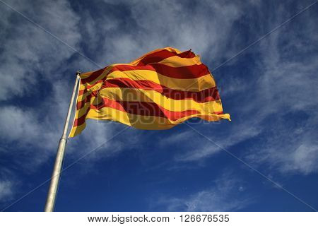 BARCELONA CATALONIA SPAIN - AUGUST 31 2012: Catalan flag fluttering in the wind