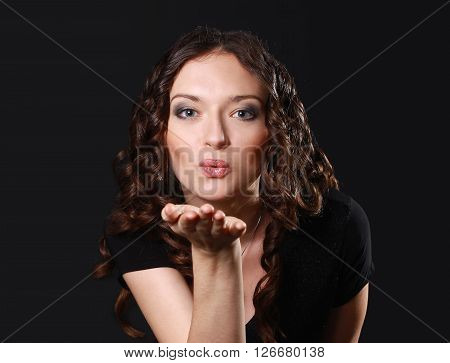 portrait of beautiful woman making a kiss