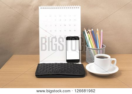 office desk : coffee with phone calendar wallet color pencil on wood background ** Note: Shallow depth of field