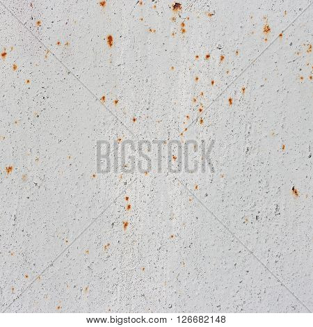 White metal background with enamel. White texture with a rust.