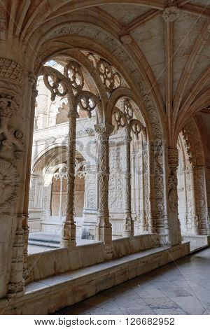 LISBON PORTUGAL - FEBRUARY 02 2016: Cloister of the Jeronimos Monastery. The Hieronymites Monastery is a monastery of the Order of Saint Jerome located near the shore of the parish of Belem in the Lisbon Municipality Portugal.