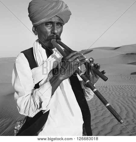Indigenous Indian Man Playing Wind Pipe Desert Concept