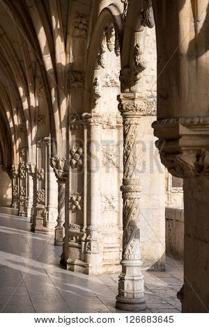 LISBON PORTUGAL - FEBRUARY 02 2016: The cloister of the Jeronimos Monastery a monastery of the Order of Saint Jerome located near the shore of the parish of Belem Lisbon Portugal.