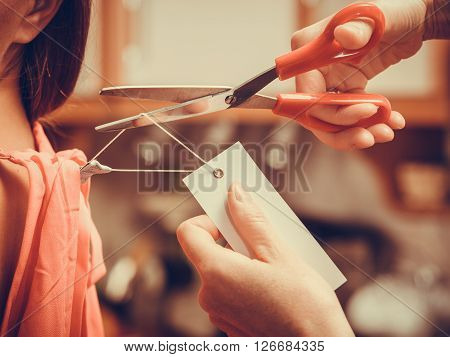 Woman Cutting Off Removing Label Board Price Tag.