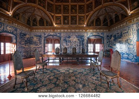 SINTRA PORTUGAL - FEBRUARY 03 2016: The coat of arms ceiling and table set of the Blason's Hall Sintra National Palace Portugal