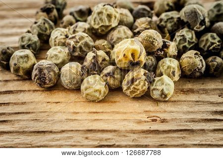 Dry Green Peppercorn  On Wooden Background