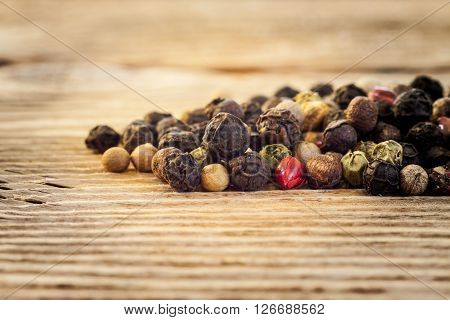 Dry  Peppercorn Mix On Wooden Background