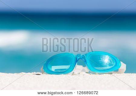 Sport Swimming Glasses On White Sand