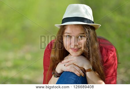 Portrait of the beautiful  girl outdoor on spring day