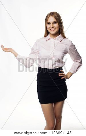 business woman is showing something with the hand and smiling on white background