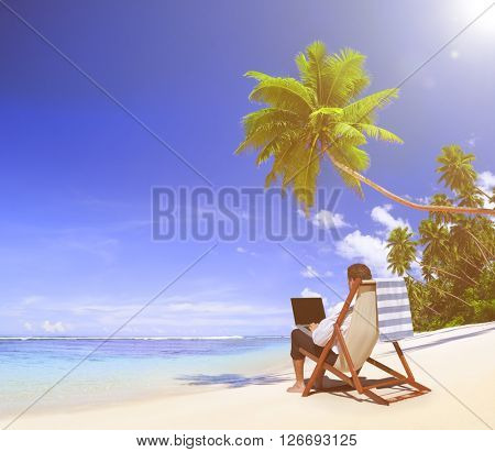 businessman working at the beach concept