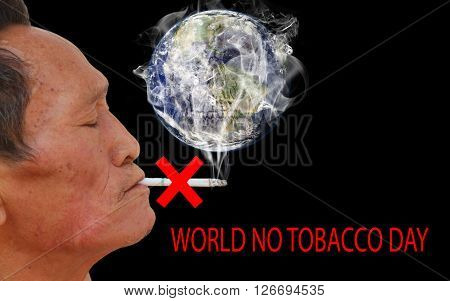 Asian old man smoking cigarette. Face filled with wrinkles. World no tobacco day May 31. isolated on black background.