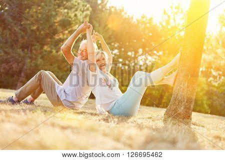 Happy senior couple having fun in summer