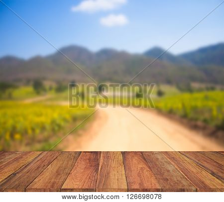 Old Wood Texture With  Blur Mountain And Field Background