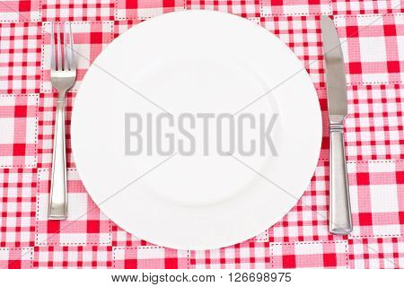 White Plate on a Checkered Tablecloth with Place for Your Text Studio Photo