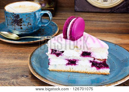 Sweet and Colourful Cake with French Macaroons with Cup of Cofee. Studio Photo