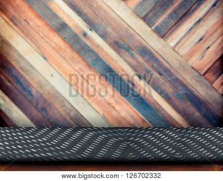 Empty Wood Table Cover With Black Fabric At Blurred Pale Plank Wooden Wall In Background