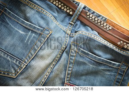 blue jeans with brown leather belt for design