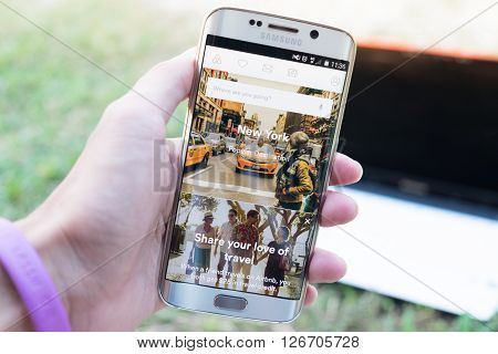 CHIANG MAI THAILAND - JAN 4 2016: A man hand holding screen shot of Airbnb on samsung galaxy s6 edge. an online platform for accommodation search and short-term private rental accommodation worldwide