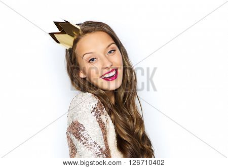 people, holidays and celebration concept - happy young woman or teen girl in party dress and princess crown