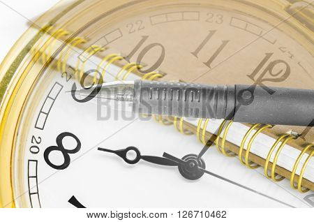 Clock face and diary with pen. Work time concept