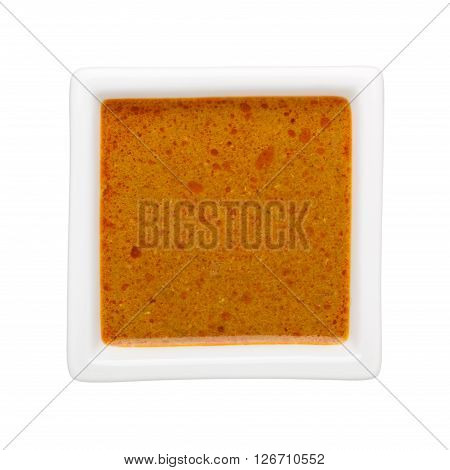 Curry in a square bowl isolated on white background
