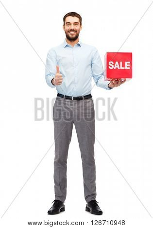 people, shopping, discount and holidays concept - smiling man holding red sale sign and showing thumbs up gesture