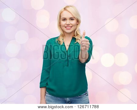 female, gender, gesture, plus size and people concept - smiling young woman in shirt and jeans showing thumbs up over pink holidays lights background