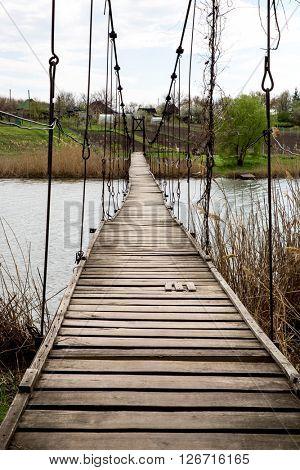 old pendant bridge over river