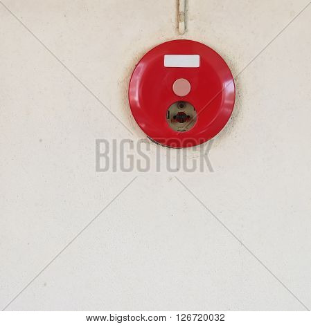 Red Fire Alarm Box For Warning Security System Mounted On Wall