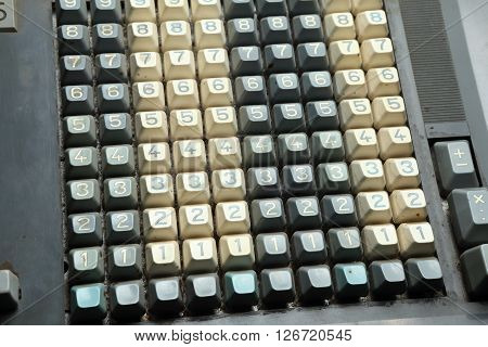 Mechanical calculator keyboard detail with white and gray keys