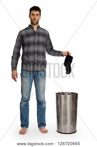 Young Man Putting Dirty Socks In A Laundry Basket