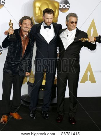 Mark A. Mangini, David White and Chris Evans at the 88th Annual Academy Awards - Press Room held at the Loews Hotel in Hollywood, USA on February 28, 2016.