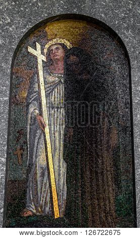 An italian mosaic in an old church showing Jesus Christ with a sinful.