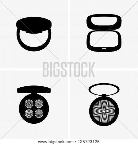 Set of four make-up powders on grey background