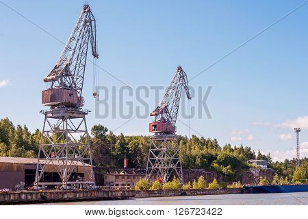 vertical photograph which shows old port crane