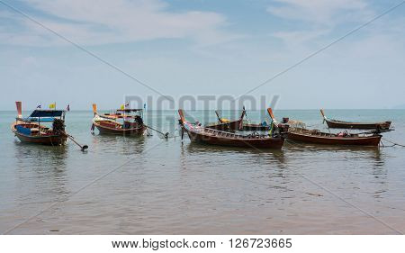 Long tail boats close to te beach