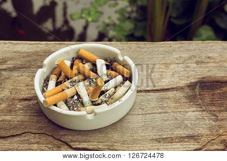 cigarette stub in ashtray image no smoking concept background